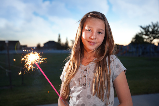 Beautiful Girl with Firework Sparkler