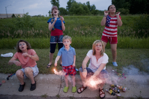 The Sartore's and the Millers watch kids light fireworks in Redwood Falls, MN.