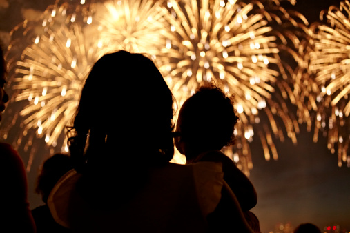Mother And Daughter Watching Fireworks Celebration 4th Of July