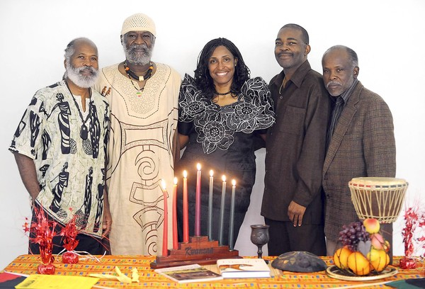Robert L. McDuffie, Jonathan Anderson, Sherry Harris, Timothy Burton and Rev. Prince Washington celebrate Kwanzaa at home and will he organizing a Kwanzaa event at the martin Luther King Center in Hollywood.12-18-2011. Jim Rassol. Sun Sentinel.